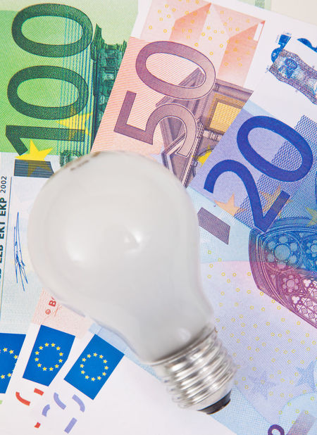 Lightbulb on euro notes Conceptual Conceptual Photography  Costs Electric Electric Supply Electricity  Euro Notes Extras Light Lightbulb Utilities