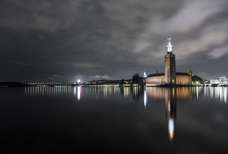Reflection Of Lighthouse In Water At Night