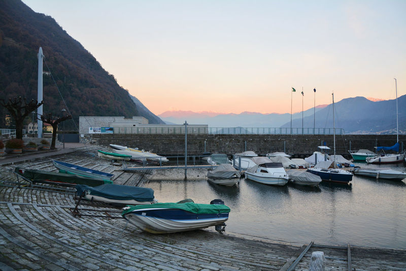 Sunset at the Harbor of Argegno, Lake Como, Lombardy, Italy. Argegno Como Day Harbor Italia Italy Lake Lake Como Lombardia Lombardy Mountain Nature Nautical Vessel No People Outdoors Sunset Water