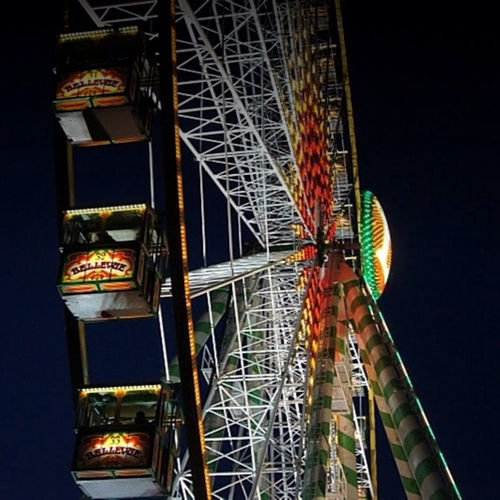 Low angle view of illuminated ferris wheel
