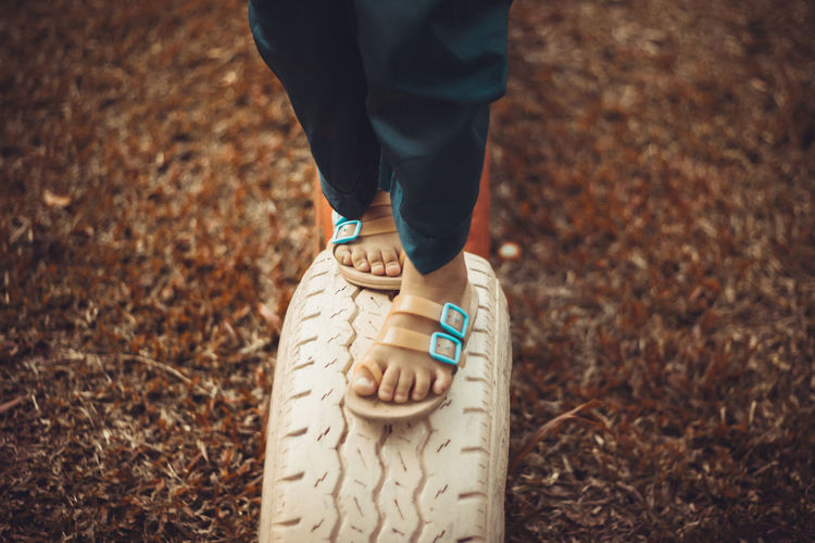 Low section of walking boy on tire