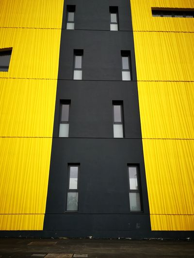 Low angle view of yellow building