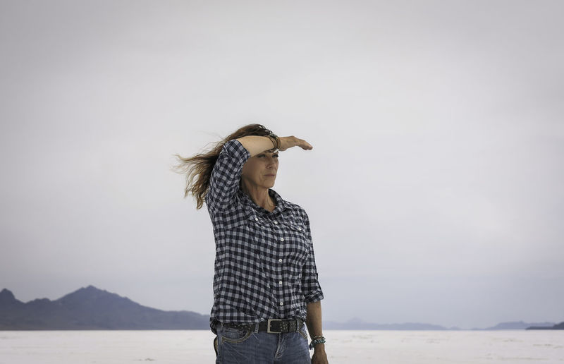 Young Woman Standing Against Clear Sky