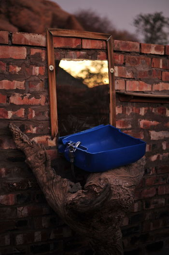 Close-up of clothes hanging on brick wall