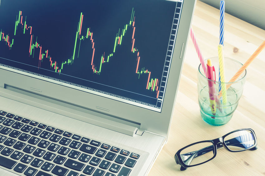 Stock or Forex Graph in Laptop Screen on Blue Vintage Style Business Candlestick RISK Stock Graph Candlestick Chart Communication Computer Computer Equipment Computer Keyboard Computer Monitor Connection Eyeglasses  Eyewear Finance Financial Glasses Investment Investment Concept Keyboard Laptop Still Life Stock Stock Pattern Technology Wireless Technology