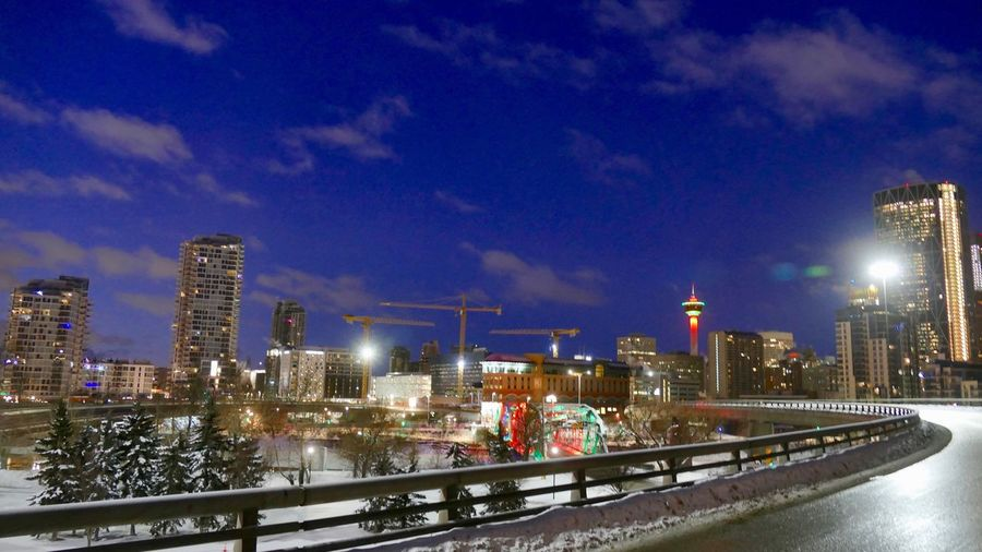 East Village from the Flyover. Guardrail Wet Road Colourful Overpass View Husky Tower Illuminated Architecture Built Structure Building Exterior City Sky Night Winter Cold Temperature City Life Cityscape No People Urban Skyline Modern