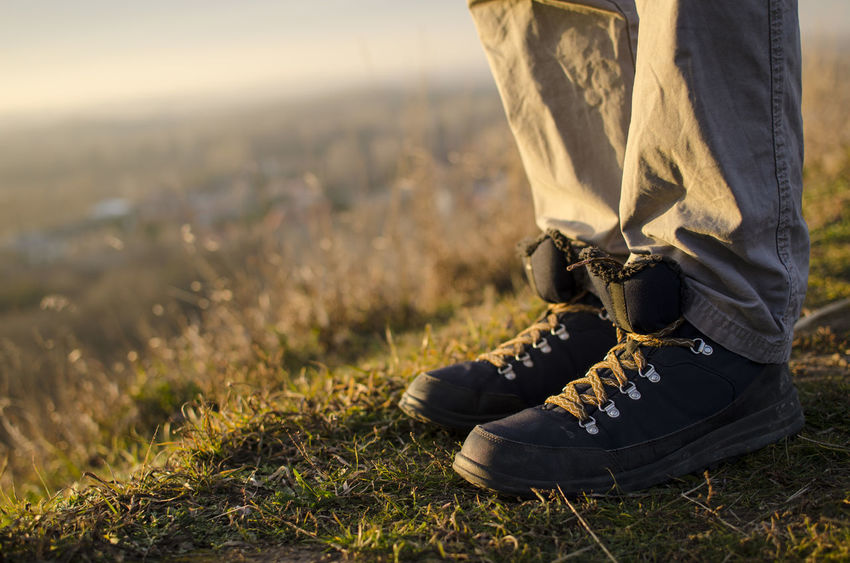 Shoe Close-up Day Field Grass Hiking Trail Hikingboots Human Body Part Human Leg Low Section Nature One Person Outdoors People Real People Selectivefocus