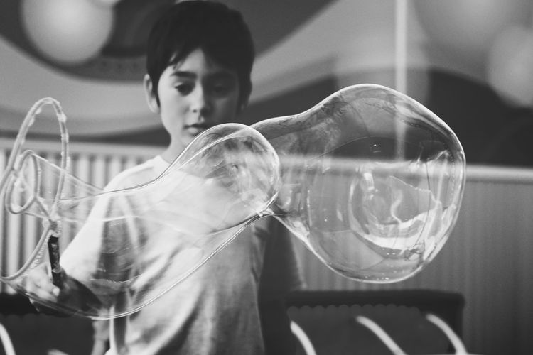 6 year old boy making giant soap bubbles at a hands-on children's museum, black and white One Person Indoors  People Lifestyles Holding Childhood Bubble Wand Standing Fragility Day Close-up Discovery Excitement Concentration Science Project Experiment Boy 6 Years Old Soap Bubbles Museum Hands On Activity Child Black And White California The Week On EyeEm