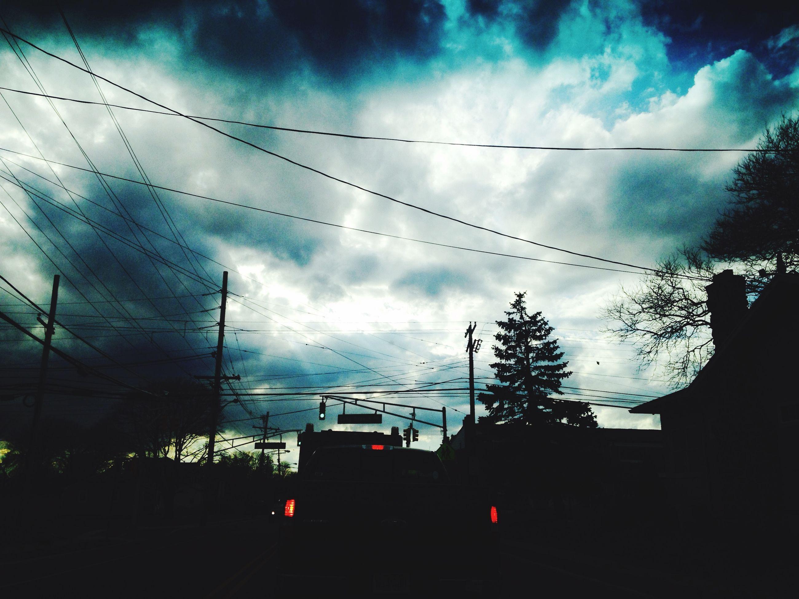 sky, cloud - sky, cloudy, cloud, power line, low angle view, built structure, silhouette, building exterior, architecture, weather, cable, connection, electricity pylon, transportation, dusk, overcast, nature, bird, storm cloud
