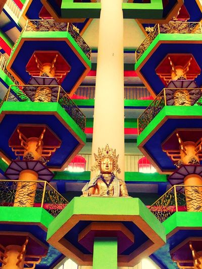 Atrium of religious fervor and color. Atrıum Ipoh,Malaysia Pagoda Reaching The Heavens Striking Colors Tambun, Malaysia Tibetan Buddhism Tibetan Temple Architecture Buddha Statue Built Structure Colorful Column Creativity Multi Colored No People Outside Tibet Place Of Worship Religion Sculpture Spirituality Statue EyeEmNewHere An Eye For Travel