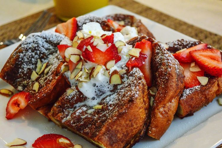 French toast topped with fresh strawberries