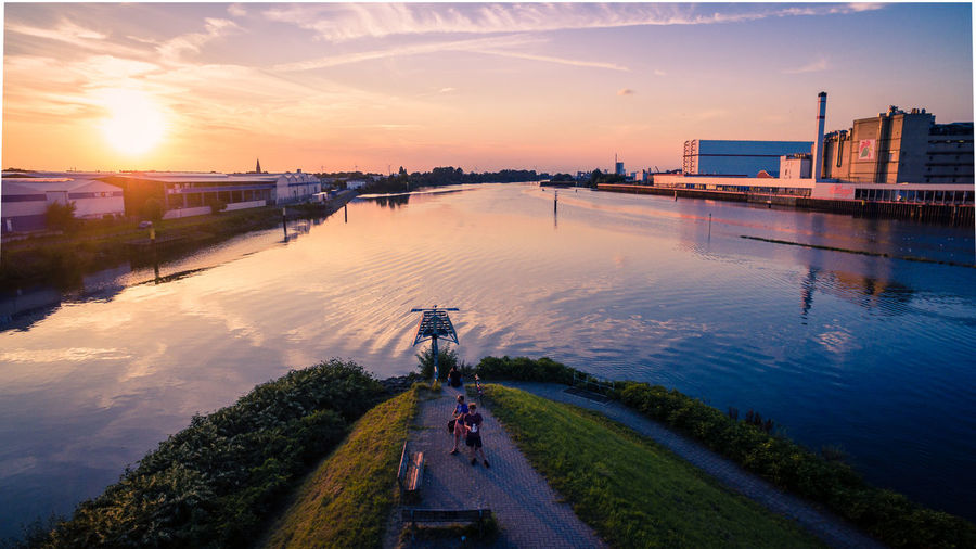 Droneshot Sunset Sky Architecture Water Building Exterior Cityscape Outdoors River Reflections High Angle View Building Street Built Structure City Cloud - Sky EyeEmNewHere