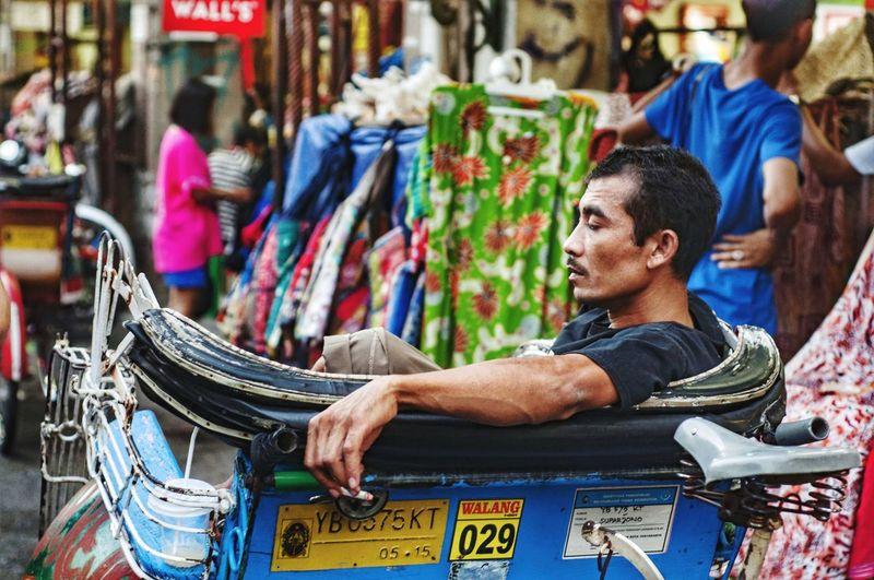 Portrait of man sitting in market