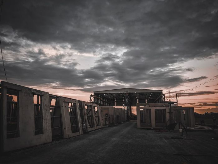 View of abandoned building at sunset