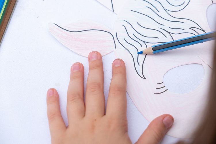 Close-up of human hand holding paper