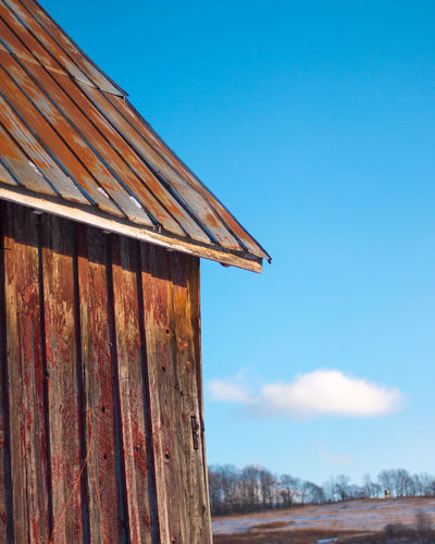 Weathered barn against a blue winter sky Barn Country Weathered Winter Building Exterior Built Structure Clear Sky Cold Day No People Roof Rural Scene Rusty Metal Rusty Roof Sky Snow Weathered Wood