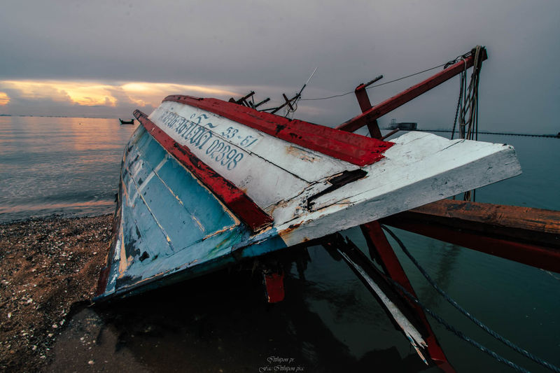 Water Sky Transportation Abandoned Nautical Vessel Mode Of Transportation Nature No People Sea Land Beach Damaged Cloud - Sky Metal Obsolete Text Decline Deterioration Outdoors Ruined