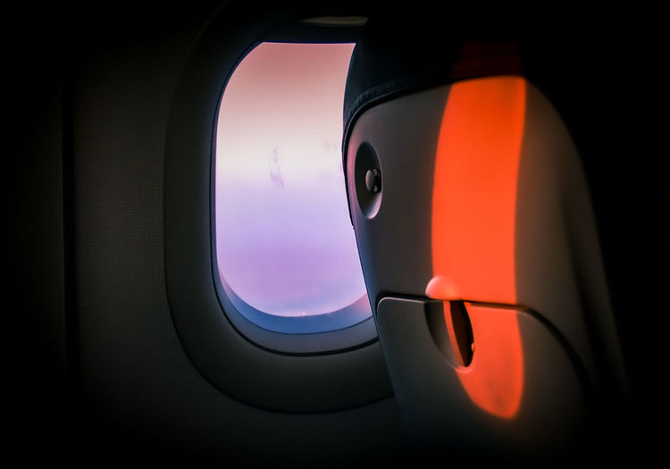 Vehicle seat by window in airplane