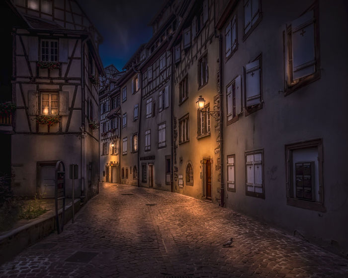 Petite Rue des Tanneurs in Colmar Alsace Colmar France HUAWEI Photo Award: After Dark Haut-Rhin Alley Architecture Building Building Exterior Built Structure City Direction Dusk Electric Lamp House Illuminated Lighting Equipment Narrow Night No People Outdoors Residential District Street The Way Forward Window EyeEmNewHere