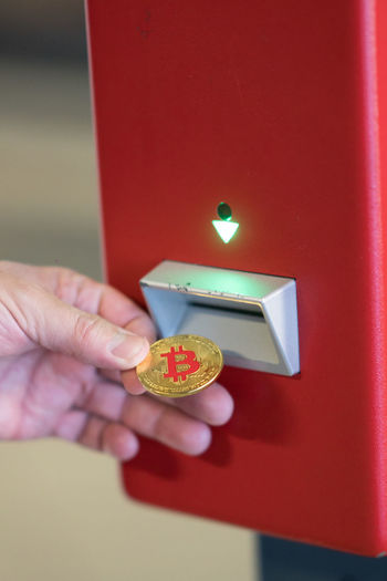 Berlin, Germany - March 19, 2018: Human hand inserting a bitcoin into a vending machine. Bitcoins are cryptocurrency and worldwide payment system, the first decentralized digital currency Business Currencies Currency Futuristic Modern Money Money Money Virtual Reality Bit Coin Bitcoin Bitcoin Coin Bitcoins Buy Buying Coin Cryptocurrency Digital Currency Digital Money Future Money Paying Payment Payment In Cash Payment System Payments Virtual Money