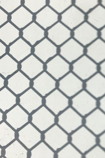Shadow Fence Wire Mesh Wire Mesh Fence Wall - Building Feature Full Frame Pattern Backgrounds Day No People Close-up Seamless Pattern Outdoors