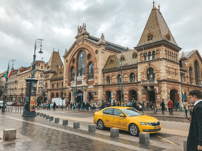 Budapest market Architecture Car Built Structure Mode Of Transportation Building Exterior Sky City Transportation Motor Vehicle Cloud - Sky Incidental People Street Building Taxi Road Travel Destinations Travel Arch Outdoors Budapest Hungary Budapest Market