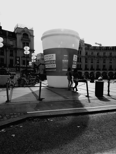 Cup Of Coffee Cup Art Big Cup Of Coffee Like Built Structure Text Architecture Sky City People Day Outdoors
