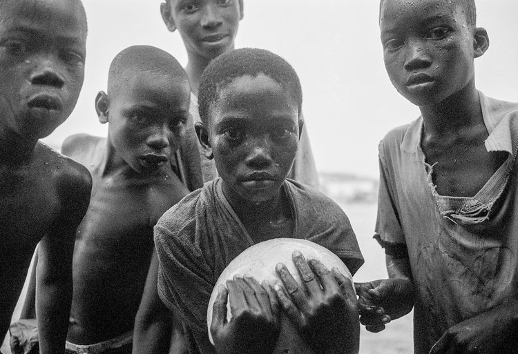 Accra African Soccer African Soccer Players Analogue Photography Ghana Ilford xp2 400 The Photojournalist - 2018 EyeE monochrome photography Passion Love For The Game Accra African Soccer African Soccer Players Analogue Photography Ghana Ilford Xp2 400 The Photojournalist - 2018 EyeEm Awards The Portraitist - 2018 EyeEm Awards Training Day Friendship Leisure Activity Looking At Camera Monochrome Playing In The Rain Soccer Hids Soccer Reportage Soccer⚽ Street Soccer Streetphotography Togetherness Training Day Baseball ⚾️⚾️ 💪 Training In The Rain World Cup 2018 Love The Game