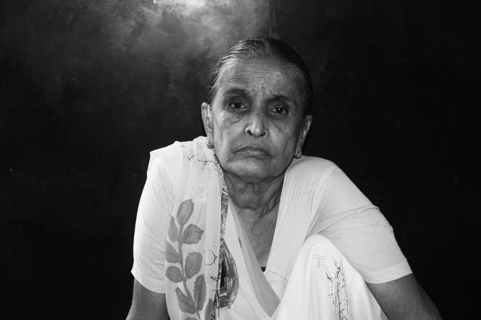 Sadness Oldwomen Painfulthoughts Darkness And LightOnly Women Blackandwhite Photography Deep In Thought Adult Portrait One Person Looking At Camera One Woman Only People Adults Only Black Background Mature Adult Human Body Part One Young Woman Only Young Adult Close-up