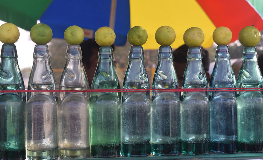 Glass Art LINE Soda Sunny Bottle Bottles Close-up Day Daylight Food Food And Drink Freshness Glass Glass - Material Glass Bottle In A Row Large Group Of Objects Lime No People Outdoor Outdoor Photography Pattern Pattern Design Still Life Summer