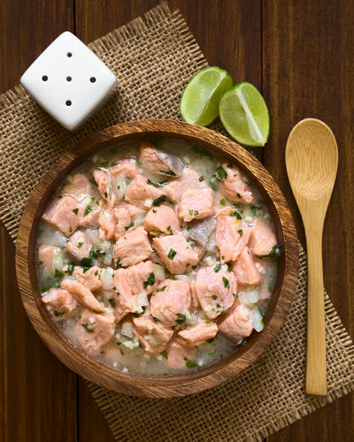 Chilean salmon ceviche prepared with onion, garlic, fresh coriander, salt and lemon juice, photographed overhead with natural light (Selective Focus, Focus on the top of the ceviche) Chile Chilean  Homemade Homemade Food Meal Raw Snack Appetizer Cebiche Ceviche Chilean Food Cilantro Coriander Fish Food Food And Drink Fresh Healthy Herb Lemon Lemon Juice Onion Raw Food Salmon Seafood