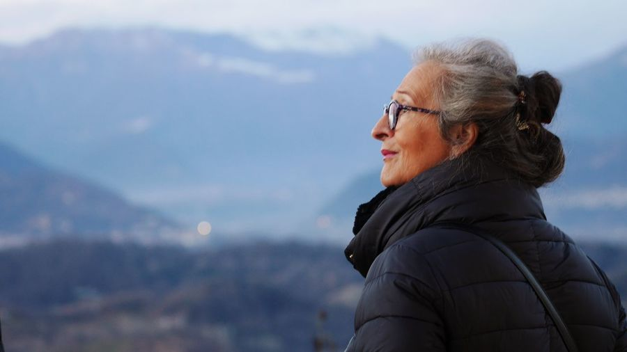 EyeEm Selects Winter Warm Clothing Portrait Headshot One Person Leisure Activity Cold Temperature Adult Nature Lifestyles Glasses Focus On Foreground Snow Day Mountain Women Real People Side View Outdoors Scarf