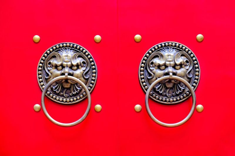 Bronze Knocker Traditional Handle Knob Red No People Red Background Close-up Art And Craft Colored Background Metal Decoration Pattern Still Life Craft