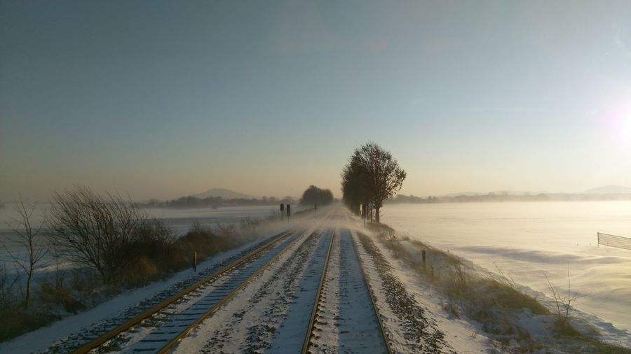 Railway Tracks In Countryside During Winter
