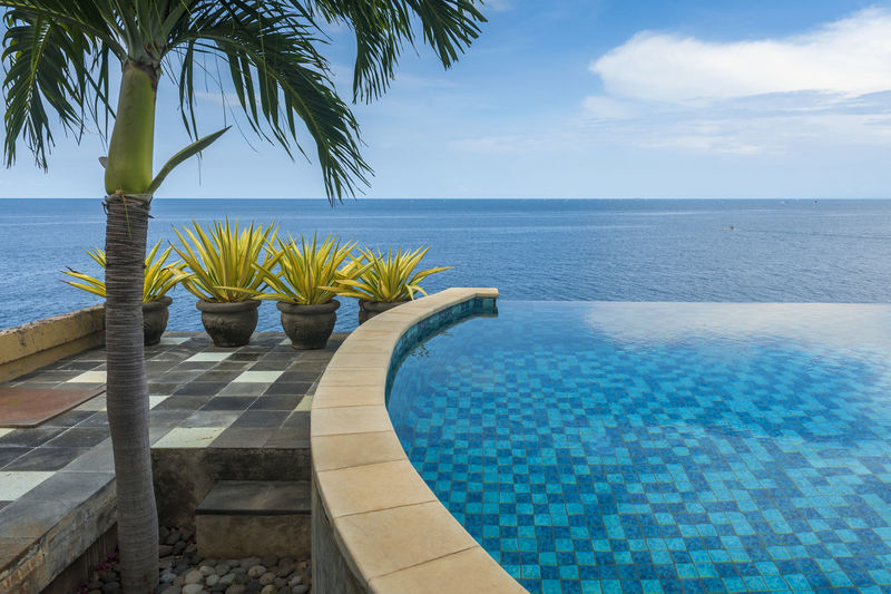 Bali, Indonesia. The view from an infinity pool overlooking the Indian Ocean. Paradise Found! Jemeluk, Amed, Bali. Bali Bali, Indonesia Beauty In Nature Blue Horizon Over Water Infinity Pool Luxury Nature No People Outdoors Palm Tree Relaxation Scenics Sea Sky Sunny Swimming Pool Tranquil Scene Tranquility Travel Travel Travel Destinations Tropical Climate Vacations Water