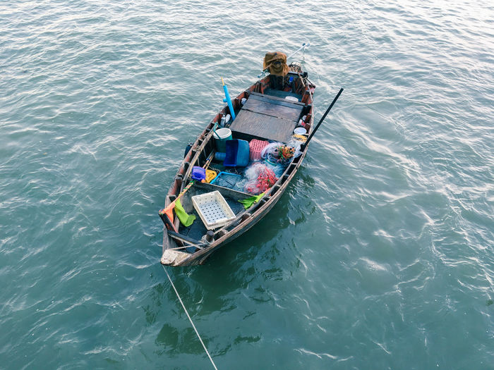 High Angle View Of Fishing Equipment In Boat