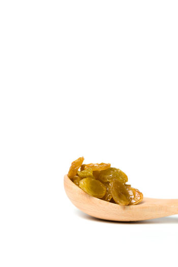 A dried raisin in a wooden spoon isolated over shite background Antioxidant Background Berry Blood Business Cooking Dried EyeEmNewHere Food Grapes Health Healthcare And Medicine Nature Nutrient Nutritious Organic Raisin Raw Snack Spoon Sugar Supplement Vegeterian White Wooden
