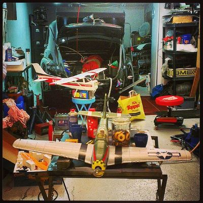 Many toys in my friends garage. Airplane HTCOneX Pv Volvo rc sweden dragracing p51 mustang