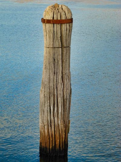 Old wooden post on the sea Post Wood Beauty In Nature Nature No People Outdoors Sea Texture Wooden Post Wooden Posts