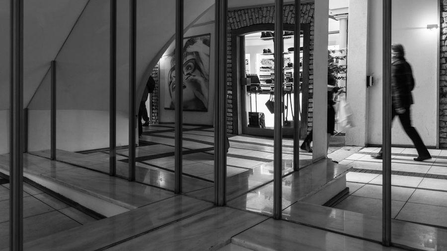 Reflection of building on glass door