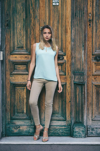 San Cristobal © Edi Libedinsky | instagram: https://www.instagram.com/edilibedinsky/ Web: www.edilibedinsky.com Beautiful Woman Beauty Casual Clothing Closed Day Door Entrance Front View Full Length Hairstyle Leisure Activity Lifestyles Looking At Camera One Person Outdoors Portrait Real People Standing Teenager Wood - Material Young Adult Young Women
