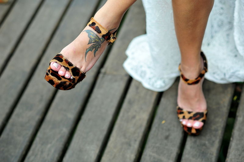 Low Section Of Woman Wearing Leopard Print Sandals