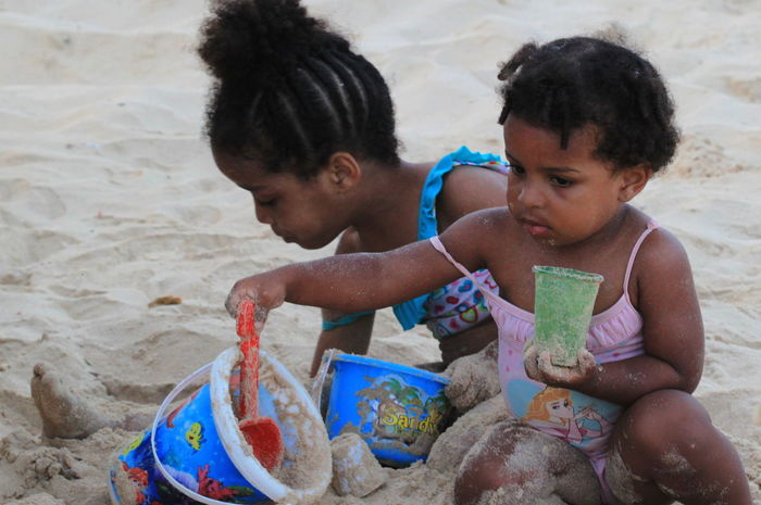 Beach Capo Verde Childhood Day Girls Lifestyles Playing Real People Sal Island Sand Sand Pail And Shovel Santa Maria Summer 2015 Togetherness Two People