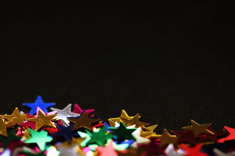 Close-up of christmas decorations on black background