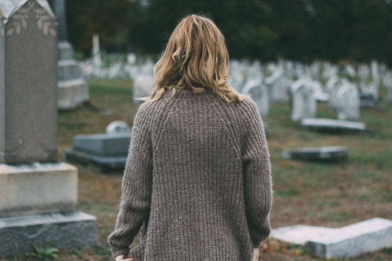 Rear view of woman at cemetery