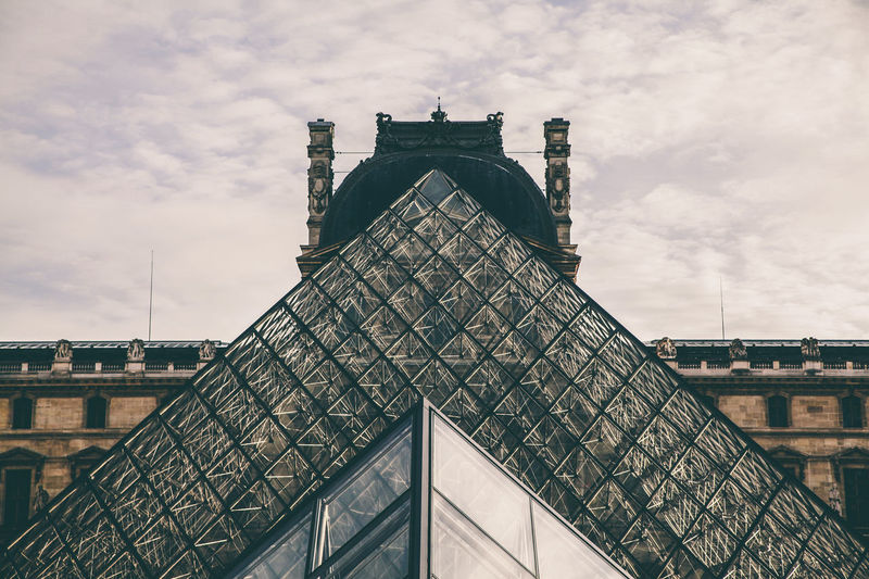 Architectural Feature Architecture Building Exterior Built Structure City Cloud Cloud - Sky Cloudy Day High Section Louvre Low Angle View Modern No People Outdoors Piramide Pyramid Pyramide Du Louvre Sky Tall - High Travel Destinations The Architect - 2016 EyeEm Awards Envision The Future
