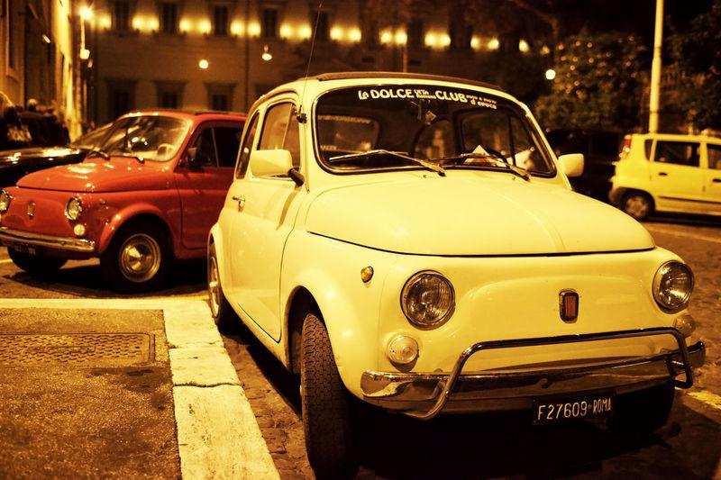 Vintage car on road at night
