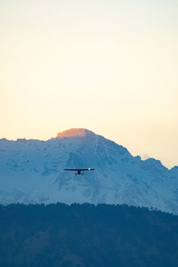 Colorado Boulder Nature Sky Mode Of Transportation Transportation Mountain Beauty In Nature Flying Air Vehicle Scenics - Nature Copy Space Tranquility Mid-air Mountain Range Sunset No People Airplane Travel Tranquil Scene Outdoors Snowcapped Mountain