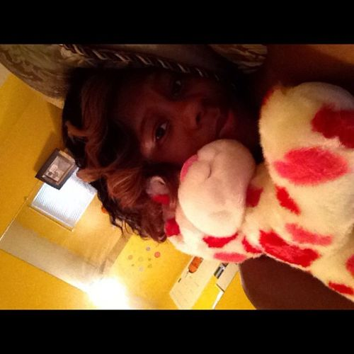This is what I look like now bumping Myhomiesstill while laying w/ my moms bear Buildabear cheeaa