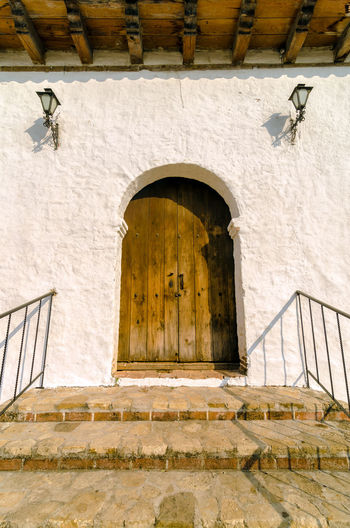 Exterior Of House With Closed Door During Sunny Day